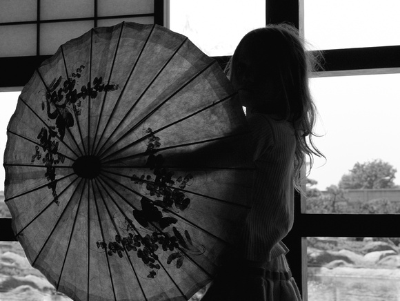Little Girl Playing with Japanese Parasol II in B&W